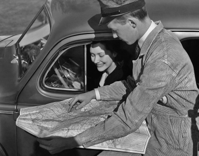 Two people looking at a map together, in order to find a route